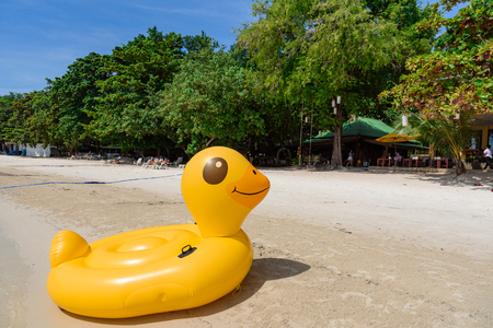 Rayong, Thailand - October, 07, 2017 : Yellow Duck swim tube on the beach Inflatable duck.Fantasy Swim Ring for Summer sea Trip on the beach at the Koh Samet island, Rayong, Thailand