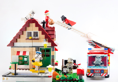 Nonthaburi, Thailand - November, 07, 2017 : Lego Darth vader climbing the ladder of a fire truck help Lego Santa get down from the roof on christmas day.Concept christmas day.