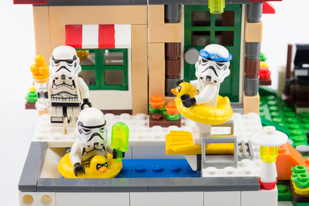 Nonthaburi, Thailand - November, 07, 2017 : Lego star war stormtrooper enjoy swimming in the pool in front of the house on holiday. Editorial