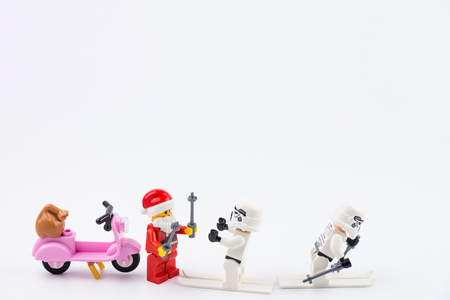 Nonthaburi, Thailand - November, 07, 2017 : Lego Santa Claus giving gifts to Lego star wars stormtrooper in Christmas day.Theme Christmas day background. Editorial