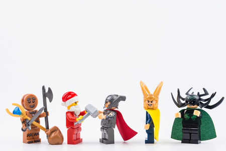 Nonthaburi, Thailand - November, 07, 2017 : Lego Santa Claus giving gifts to Lego thor ragnarok in Christmas day.Theme Christmas day background. Editorial