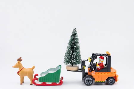 Nonthaburi, Thailand - November, 14, 2017 : Lego Santa Claus forklift driver transport christmas trees to snow sled at Christmas day.Theme Christmas day background. Editorial