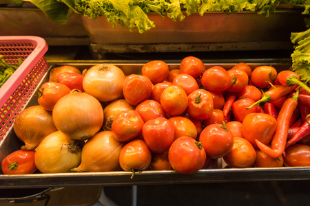 Box of tomatoes on the counter in night market.Thailand