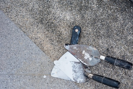 The trowel on the concrete floor