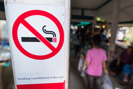 No smokin sign in the market with a blurry background.Thailand