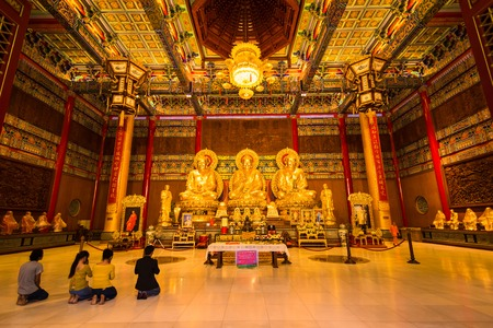 Nonthaburi, Thailand - December, 31, 2017 : Golden Buddha Statue to pray inside Leng Noei Yi 2 chinese temple at Nonthaburi, Thailand