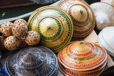 Hat-weaving, handmade goods, and is one of the souvenirs sold in the Damnoen Saduak floating market