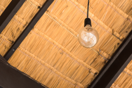 Light bulb under a Thai local pavilion made from dried leaves of the nipa palm