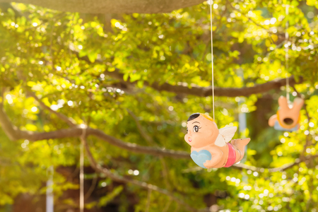 Colorful Angel ceramic doll hanging in the garden