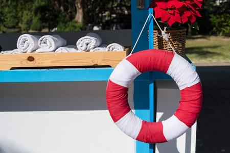 Life buoy or lifesaver, hanging at swimming pool