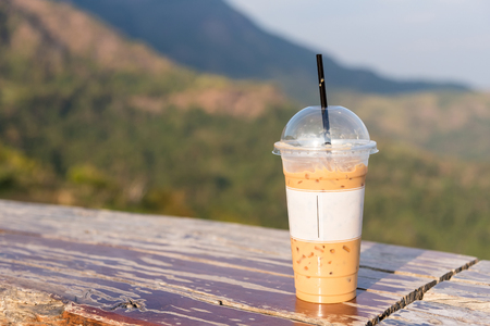 The sweet cooled thai coffee drink with ice on Natural background.Thailand Stock Photo