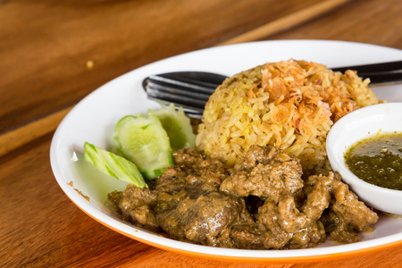 Thai Muslim local traditional yellow boiled rice with dry sliced beef meat,
