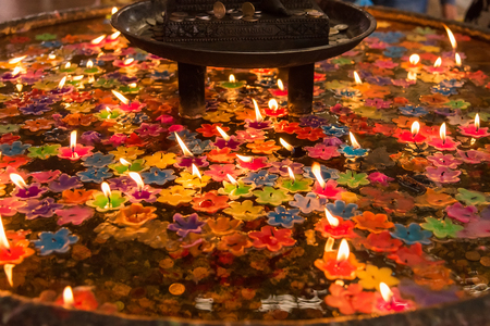 Holy water basin for floating  flower candle to pray to god for good luck.Thailand