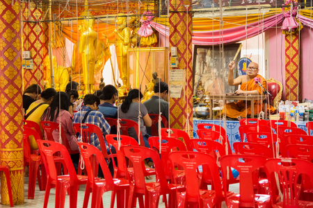 Nonthaburi, Thailand - February, 04, 2018 : Monk bless the people With the sprinkling of holy water at Wat Takian temple Nonthaburi, Thailand