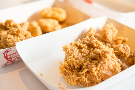 Nonthaburi, Thailand - March, 07, 2018 : Close up fried chicken on the table in a Kentucky Fried Chicken (KFC) restaurant at Nonthaburi, Thailand Editorial