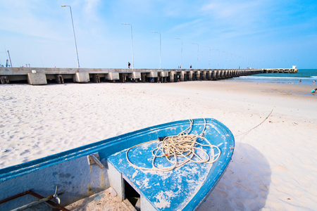 Fishing boats aground on the beach over cloudy sky at Prachuap Khiri Khan, Thailand Stock Photo