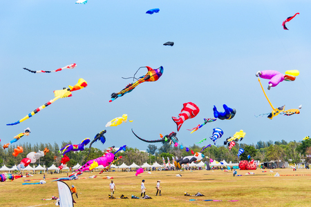 Prachuab Khirikhan, Thailand - March, 25, 2018 : Various colorful kites flying in the sky during a kite festival at Prachuab Khirikhan, Thailand