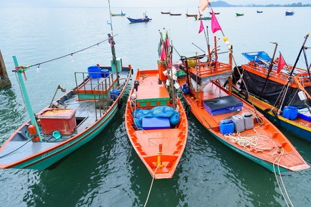 Chanthaburi, Thailand - April, 27, 2018 : Floating fishing boats aground at the harbor over cloudy sky at Chanthaburi, Thailand Editorial