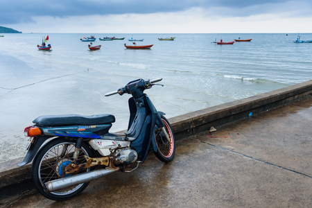 Chanthaburi, Thailand - April, 28, 2018 : The old motorcycle on the chaolao harbor bridge in the morning over cloudy sky at Chanthaburi, Thailand