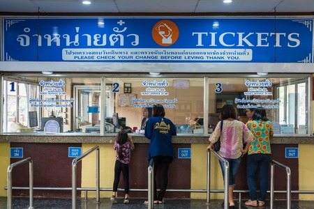 Saraburi, Thailand - April, 29, 2018 : Unidentified name People buy train tickets at ticket booths in Lop Buri railway station at Lop Buri, Thailand