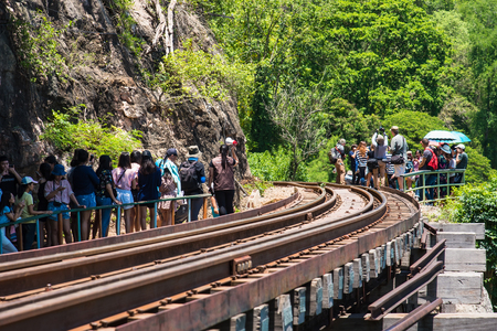 Kanchanaburii, Thailand - May, 13, 2018 : World war II historic railway, known as the Death Railway with a lot of tourists on the train taking photos of beautiful views at Kanchanaburii, Thailand