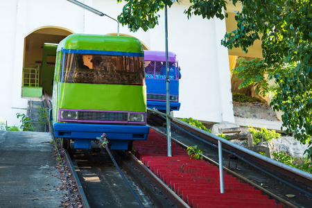 Kanchanaburii, Thailand - May, 13, 2018 : View of a funicular railway used to go up and down to Wat thum sue temple at kanchanaburi thailand most popular religion traveling destination