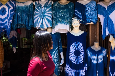 Kanchanaburii, Thailand - May, 13, 2018 : Clothes Shop selling a colorful tie dye batik clothes traditional handmade. Thai clothes style at Kanchanaburii, Thailand Editorial