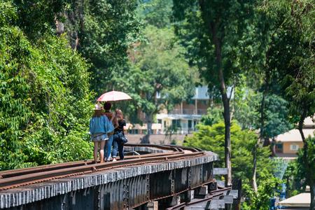 Kanchanaburii, Thailand - May, 13, 2018 : Unidentified tourists walking and taking photos on World war II historic railway, known as the Death Railway at Kanchanaburii, Thailand