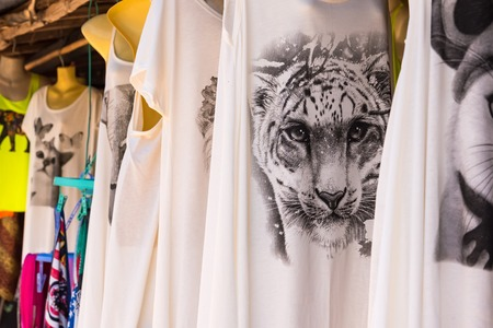Kanchanaburii, Thailand - May, 13, 2018 : Colorful t-shirts about the image of tiger souvenir clothing on sale at Kanchanaburii, Thailand