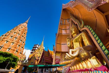 Kanchanaburii, Thailand - May, 13, 2018 : Big golden buddha statue in wat thum sue temple kanchanaburi thailand most popular religion traveling destination