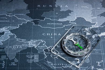 Compass on the world map.Business travel world wide system concept