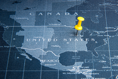 Yellow pin on the world map pin to United States of america countries.Business world wide system concept