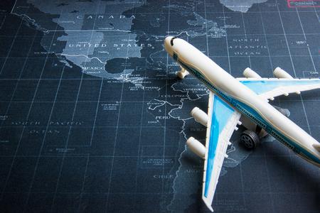 Passenger plane on the world map.Business transportation system concept Stock Photo