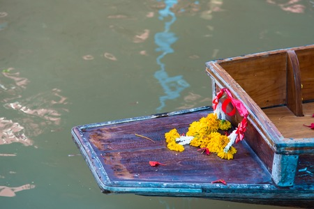 Garlands for good luck at the heading of the boat.Thailand