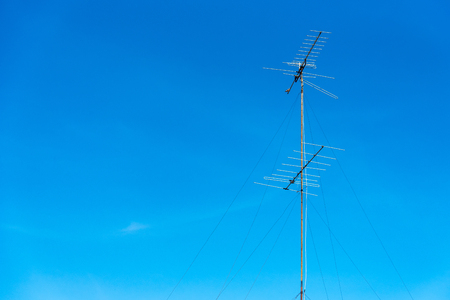 Analog tv antenna with blue sky background