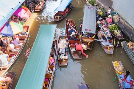 Ratchaburi,Thailand - June, 02, 2018 : Unidentified woman vendor food floats in a boat at Damnoen Saduak floating market Ratchaburi, Thailand. Editorial