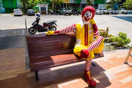 Bangkok,Thailand - June, 02, 2018 : Mascot of McDonalds restaurant, Ronald McDonald posed sit on the bench to greeting customer in Bangkok, Thailand.