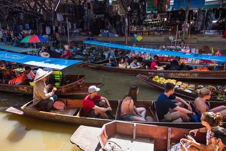 Ratchaburi,Thailand - June, 02, 2018 : Unidentified name tourists njoy traveling on a boat tour to Damnoen Saduak floating market Ratchaburi, Thailand.