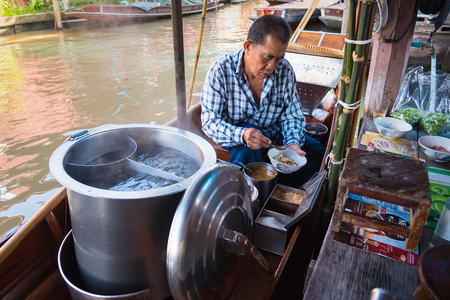 Ratchaburi,Thailand - June, 02, 2018 : Unidentified man sell noodle on the boat at traditional floating market, Ratchaburi, Thailand