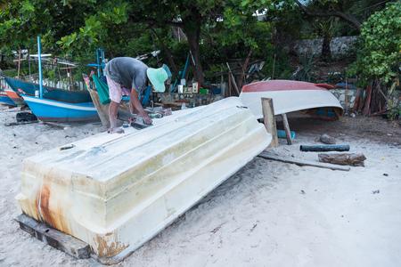 Prachuap Khiri Khan,Thailand - June, 02, 2018 : Unidentified name Repairing man are repairing the floor of the boat on the beach at Huahin beach of Prachuap Khiri Khan,Thailand