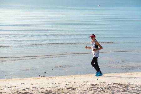 Prachuap Khiri Khan,Thailand - June, 03, 2018 : Unidentified running man on beach. Sportsman run jogging guy during the sunrise above sandy beach at Hua Hin Beach Prachuab Khirikhan, Thailand.