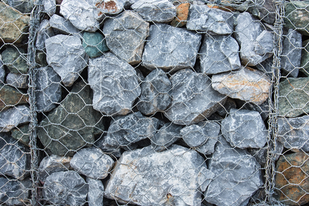 Texture Stone with wire mesh for falling rock protection.Thailand Stock Photo