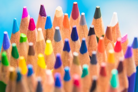 Back to school set multicolored pencils colorful making forms side view on a bule backround Banco de Imagens
