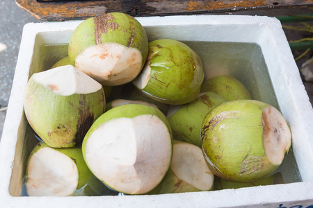 Coconut juice and fresh soaked in an ice bucket.