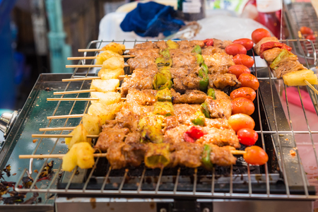 Barbecue grill with various kinds of meat, close-up