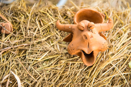 Laughing buffalo pottery on wooden background Stock Photo