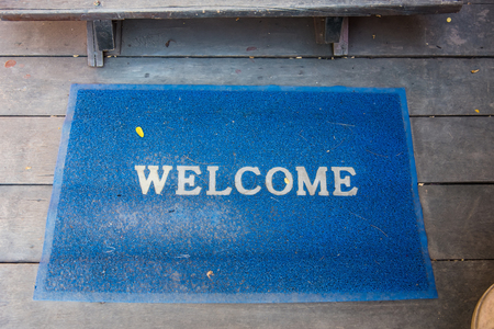 Welcome mat on the floor background