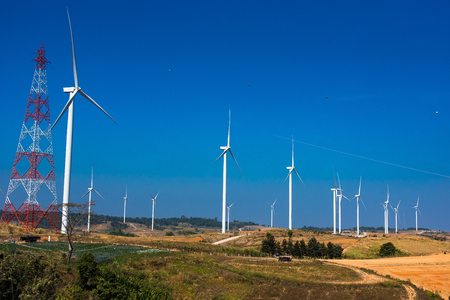 Power of wind turbine generating electricity clean energy with cloud background on the blue sky.Global ecology.Clean energy concept save the world Standard-Bild