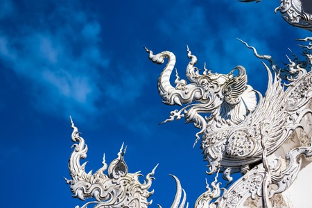 Decoration on top of roof at Wat Rong Khun Chiang Rai province Thailand