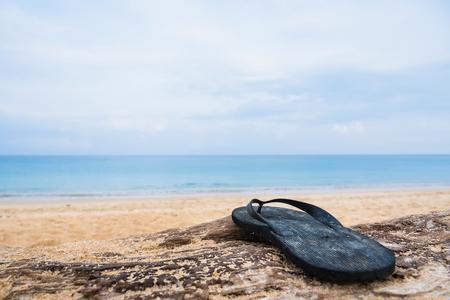 Beach slippers on a sandy beach in Phuket, Thailand